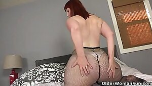 cute american milf rims and fucks her tight pussy with big dildo