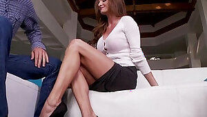 Busty MILF footworshiped on the couch