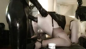 Sissy slave in latex got fisted by latex mistress