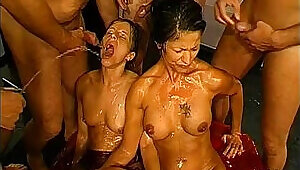 Piss drinking bitches gets goldenshower in gangbang