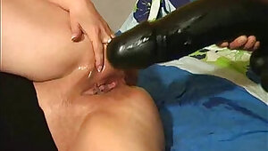 Breaking her vagina with a gigantic monster dildo
